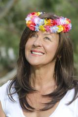 Senior woman flower in hair outdoor