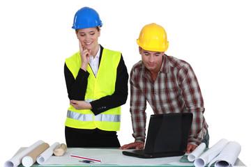 Tradesman and engineer working together