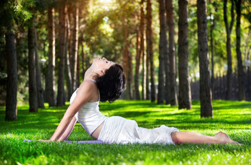 Yoga cobra pose in the park