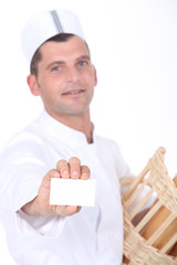 Baker with breadbasket and business card
