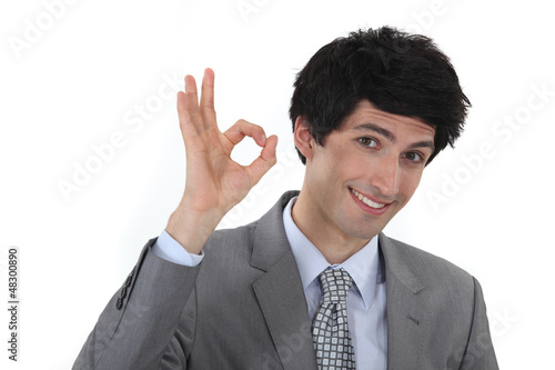 businessman making an OK sign