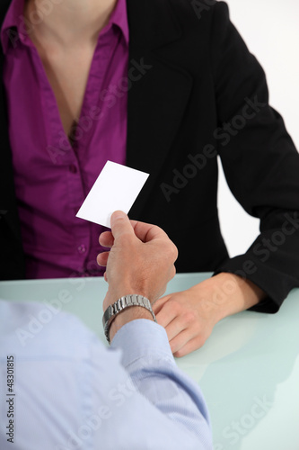 businessman giving his business card