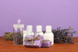 ingredients for soap making on violet background