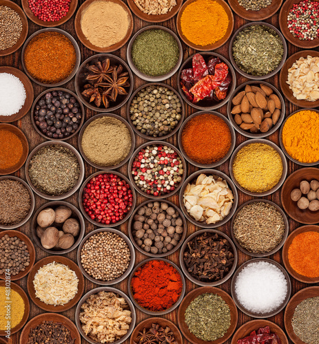 Various kinds of spices on wooden background - 48302874