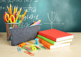 Back to school - blackboard with pencil-box and school