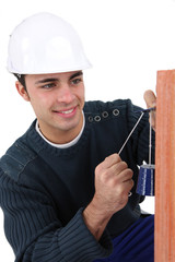 Worker checking wall is straight