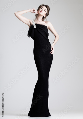 beautiful woman model posing in elegant dress in the studio