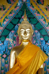 Golden Buddha figure set against a colorful background