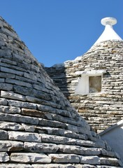 The roofs of trulli houses in Alberello in Italy