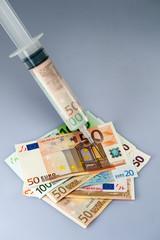 Spritze mit Geld, Geldspritze