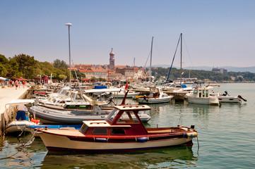 Ships and boats docked at Krk city Port - Croatia