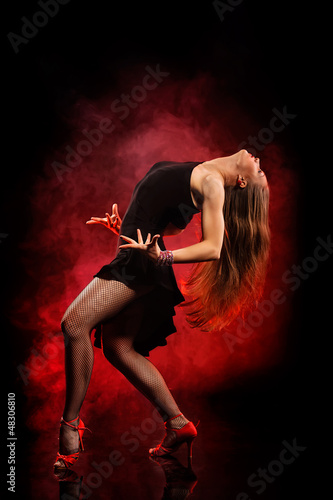 modern style dancer posing on dark background