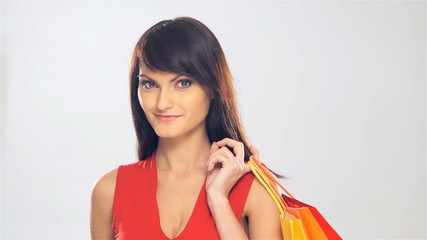 Portrait of a young Caucasian woman holding shopping bags
