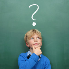 Child at the Blackboard with question Mark