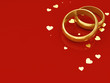 Golden wedding rings on red background