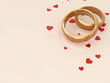 Golden wedding rings on beige background