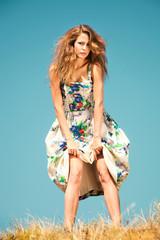 fashion woman in silky dress, outdoor shot, summer day