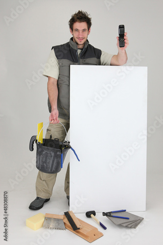 Man advertising his tiling services