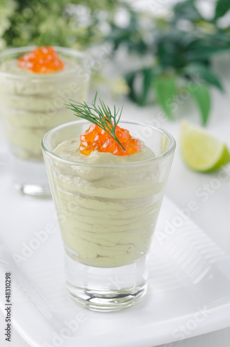 Avocado mousse with caviar portions closeup