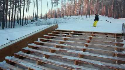 Snowboarder sliding the rail