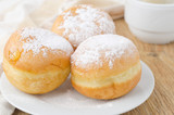 Fototapety three sweet donuts sprinkled with powdered sugar