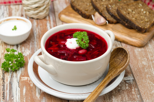 Ukrainian and russian national red borsch with sour cream