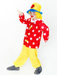 Funny child as a clown deancing in a carnival costume
