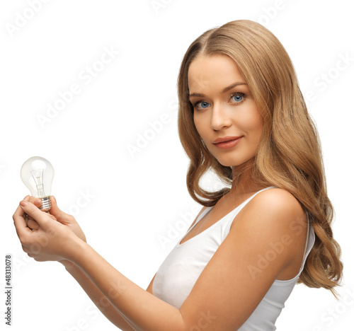 woman with energy saving bulb