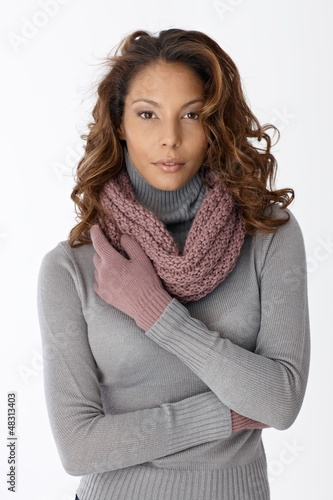 Beautiful ethnic woman in scarf and gloves