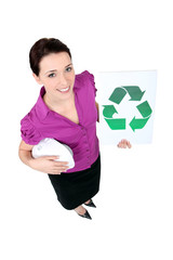 Woman showing recycling logo