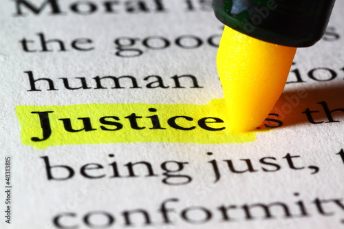 Word justice highlighted with a yellow marker