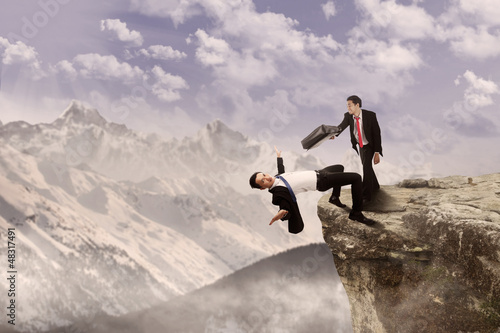 Business battle on top of cliff