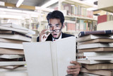 Businessman on shock looking at books