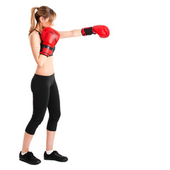 Young woman wearing boxe gloves isolated on white