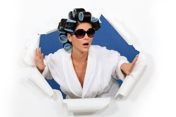 Surprised woman in hair rollers