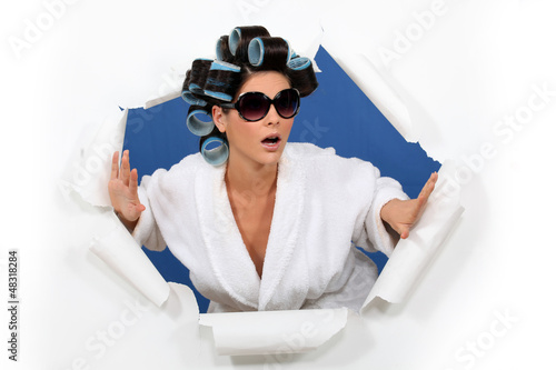 Surprised woman in hair rollers