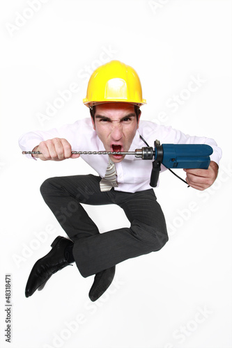 A mad architect biting a drill.