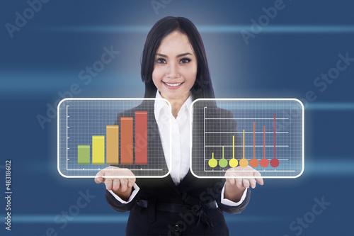Businesswoman shows virtual diagrams