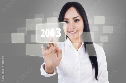 Businesswoman touch screen 2013