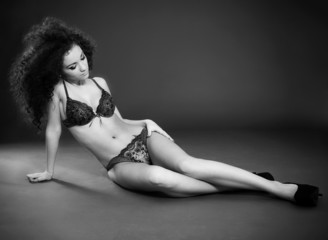 Black and white portrait of stunning curly woman