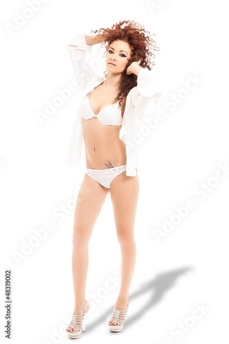 Amazing curled hair woman with lingerie and shirt