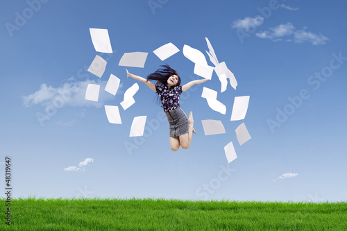 Happy businesswoman throw papers