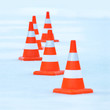 Red and white striped cones on the ice
