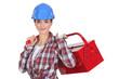A handywoman holding a toolbox.