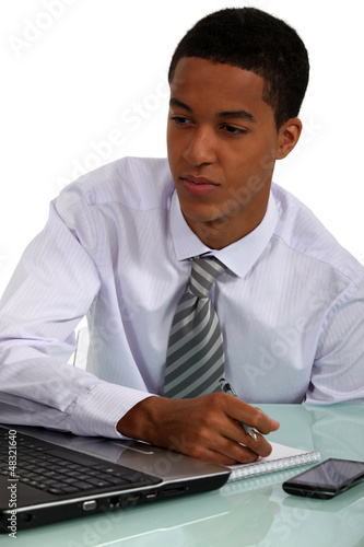 young Afro-American businessman working at his desk