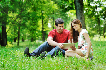 Cheerful couple using digital tablet