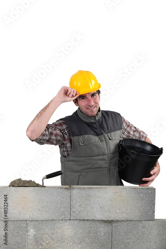 Man laying a blocks wall