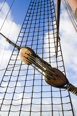 Marine rope ladder at ship. Ladder upstairs on the mast against