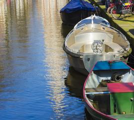 Modern boats on the canal of Amsterdam