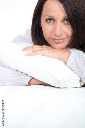 Woman hugging her pillow